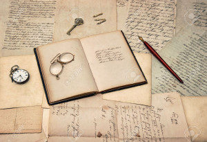 30119649-antique-writing-accessories-open-diary-book-old-letters-and-stock-photo